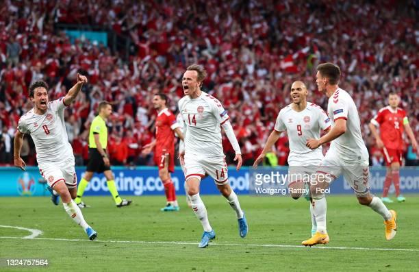 Mikkel Damsgaard of Denmark celebrates with teammates Martin Braithwaite, Joakim Maehle and Thomas Delaney after scoring their side's first goal...
