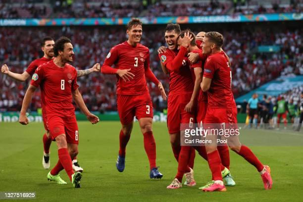 Mikkel Damsgaard of Denmark celebrates with Thomas Delaney, Jannik Vestergaard, Andreas Christensen and Jens Stryger Larsen after scoring their...
