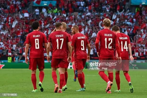 Mikkel Damsgaard of Denmark celebrates with Thomas Delaney, Jens Stryger Larsen, Martin Braithwaite and Kasper Dolberg after scoring their side's...