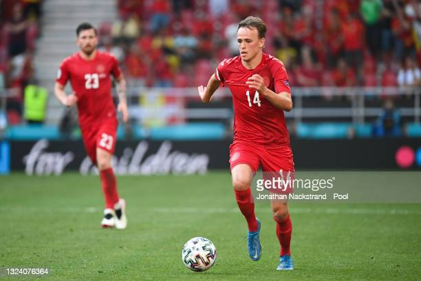 Mikkel Damsgaard of Denmark runs with the ball during the UEFA Euro 2020 Championship Group B match between Denmark and Belgium at Parken Stadium on...