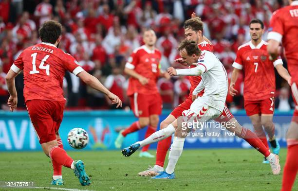 Mikkel Damsgaard of Denmark scores their side's first goal during the UEFA Euro 2020 Championship Group B match between Russia and Denmark at Parken...