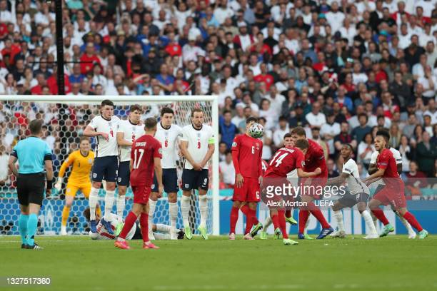 Mikkel Damsgaard of Denmark scores their side's first goal during the UEFA Euro 2020 Championship Semi-final match between England and Denmark at...