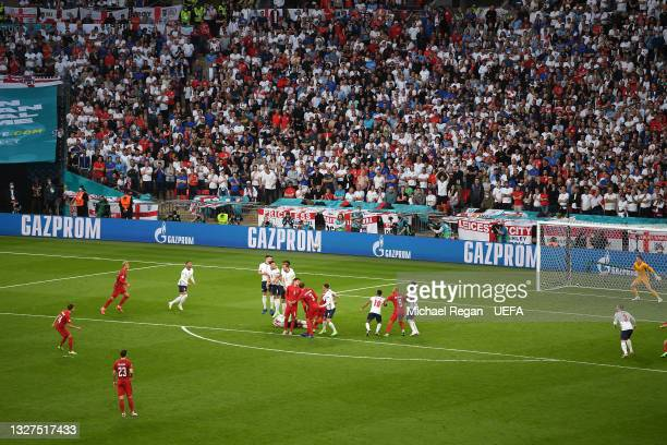 Mikkel Damsgaard of Denmark scores their side's first goal past Jordan Pickford of England during the UEFA Euro 2020 Championship Semi-final match...