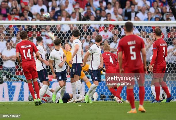 Mikkel Damsgaard of Denmark scores their team's first goal from a free kick during the UEFA Euro 2020 Championship Semi-final match between England...