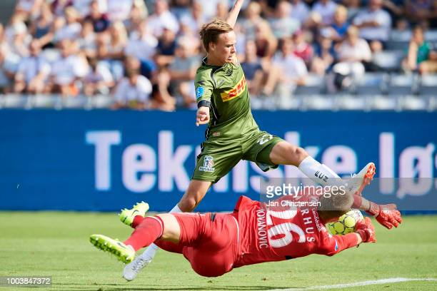 Mikkel Damsgaard of FC Nordsjalland and Goalkeeper Aleksandar Jovanovic of AGF Arhus compete for the ball during the Danish Superliga match between...