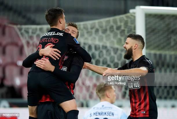 Mikkel Duelund Alexander Sorloth and Marc Dal Hende of FC Midtjylland celebrate after scoring their first goal during the Danish Alka Superliga match...