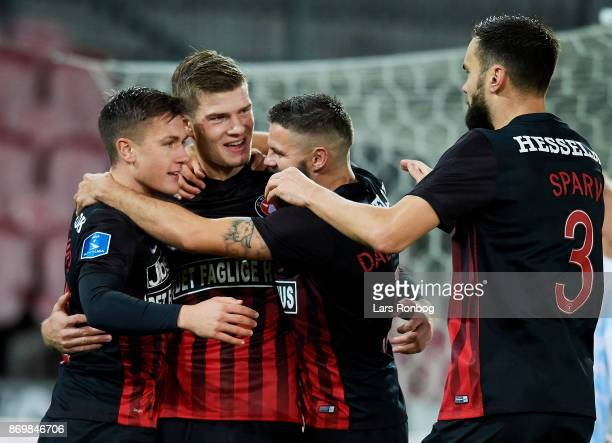 Mikkel Duelund Alexander Sorloth and Marc Dal Hende of FC Midtjylland celebrate after scoring their first goal during the Danish Alka Superliga match...