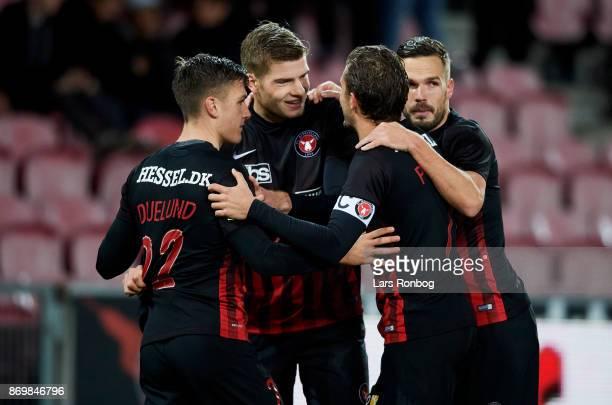 Mikkel Duelund Alexander Sorloth Jakob Poulsen and Filip Novak of FC Midtjylland celebrate after scoring their first goal during the Danish Alka...