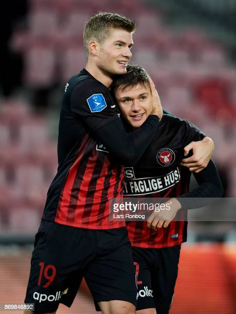 Mikkel Duelund and Alexander Sorloth of FC Midtjylland celebrate after scoring their first goal during the Danish Alka Superliga match between FC...