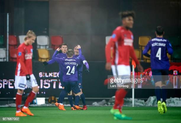 Mikkel Duelund Jakob Poulsen and Mads Dohr Thychosen of FC Midtjylland celebrate after scoring their second goal during the Danish Alka Superliga...