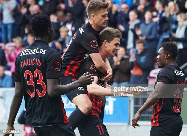 Mikkel Duelund Jonas Borring and Rilwan Hassan of FC Midtjylland celebrate after scoring their second goal during the Danish Alka Superliga match...