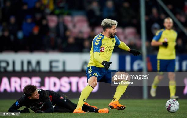 Mikkel Duelund of FC Midtjylland and Anthony Jung of Brondby IF compete for the ball during the Danish Alka Superliga match between FC Midtjylland...