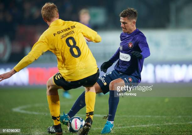 Mikkel Duelund of FC Midtjylland and Bjarke Jacobsen of AC Horsens compete for the ball during the Danish Alka Superliga match between AC Horsens and...