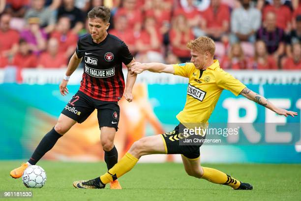 Mikkel Duelund of FC Midtjylland and Bjarke Jacobsen of AC Horsens compete for the ball during the Danish Alka Superliga match between FC Midtjylland...