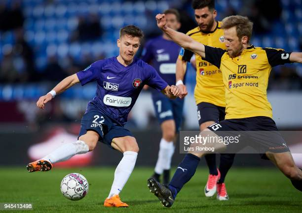 Mikkel Duelund of FC Midtjylland and Bjorn Kopplin of Hobro IK compete for the ball during the Danish DBU Pokalen Cup quarterfinal match between...