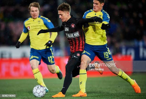 Mikkel Duelund of FC Midtjylland and Christian Norgaard of Brondby IF compete for the ball during the Danish Alka Superliga match between FC...