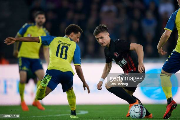 Mikkel Duelund of FC Midtjylland and Hany Mukhtar of Brondby IF compete for the ball during the Danish Alka Superliga match between FC Midtjylland...