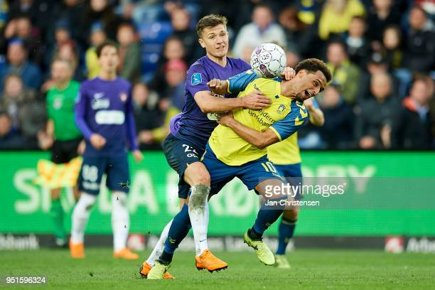 Mikkel Duelund of FC Midtjylland and Hany Mukhtar of Brondby IF compete for the ball during the Danish DBU Pokalen Cup Semifinal match between...