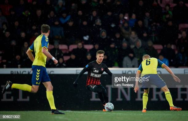 Mikkel Duelund of FC Midtjylland and Hjortur Hermannsson of Brondby IF compete for the ball during the Danish Alka Superliga match between FC...