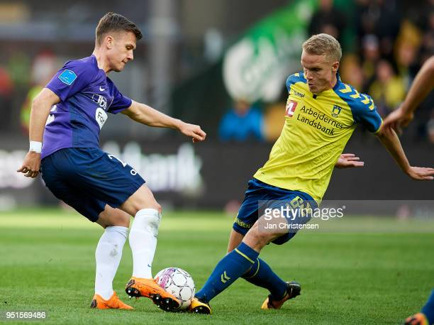 Mikkel Duelund of FC Midtjylland and Hjötur Hermannsson of Brondby IF compete for the ball during the Danish DBU Pokalen Cup Semifinal match between...