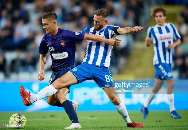 Mikkel Duelund of FC Midtjylland and Janus Drachmann of OB Odense compete for the ball during the Danish Superliga match between OB Odense and FC...