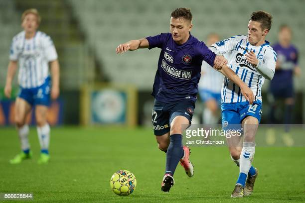Mikkel Duelund of FC Midtjylland and Jens Jakob Thomasen of OB Odense compete for the ball during the Danish Cup DBU Pokalen match between OB Odense...