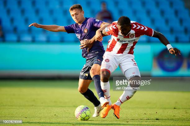 Mikkel Duelund of FC Midtjylland and Jores Okore of AaB Aalborg compete for the ball during the Danish Superliga match between AaB Aalborg and FC...