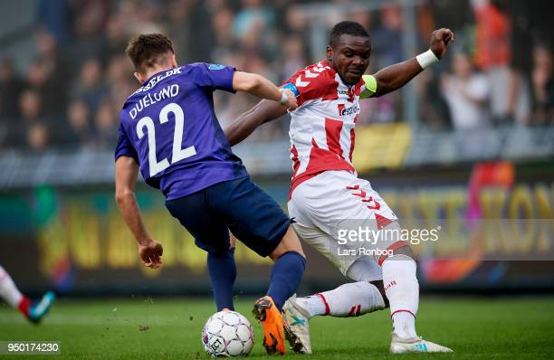 Mikkel Duelund of FC Midtjylland and Jores Okore of AaB Aalborg compete for the ball during the Danish Alka Superliga match between AaB Aalborg and...