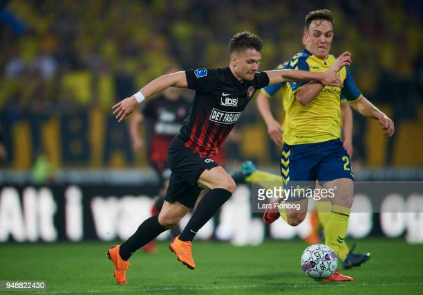 Mikkel Duelund of FC Midtjylland and Lasse Vigen Christensen of Brondby IF compete for the ball during the Danish Alka Superliga match between FC...