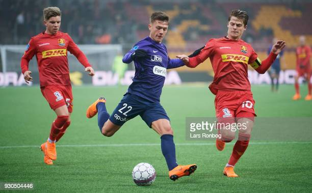 Mikkel Duelund of FC Midtjylland and Mathias Jensen of FC Nordsjælland compete for the ball during the Danish Alka Superliga match between FC...