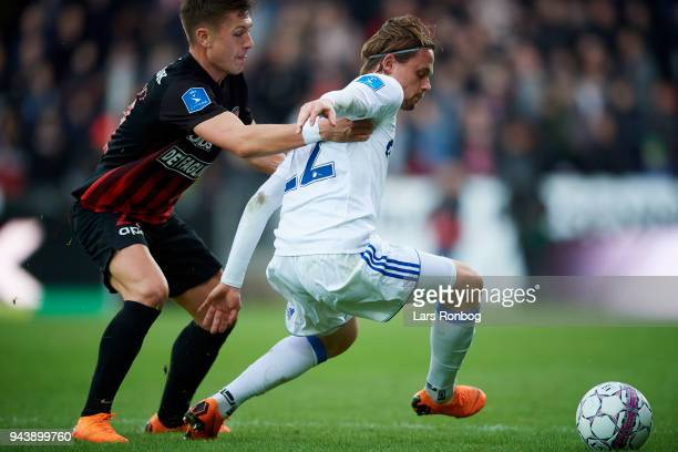 Mikkel Duelund of FC Midtjylland and Peter Ankersen of FC Copenhagen compete for the ball during the Danish Alka Superliga match between FC...