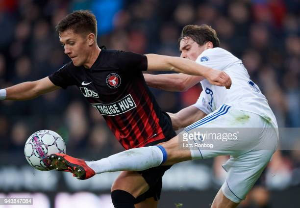 Mikkel Duelund of FC Midtjylland and Robert Skov of FC Copenhagen compete for the ball during the Danish Alka Superliga match between FC Midtjylland...