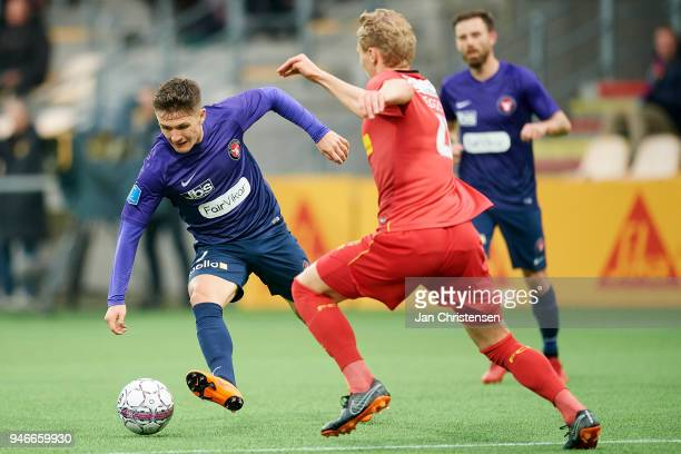 Mikkel Duelund of FC Midtjylland and Victor Nelsson of FC Nordsjalland compete for the ball during the Danish Alka Superliga match between FC...