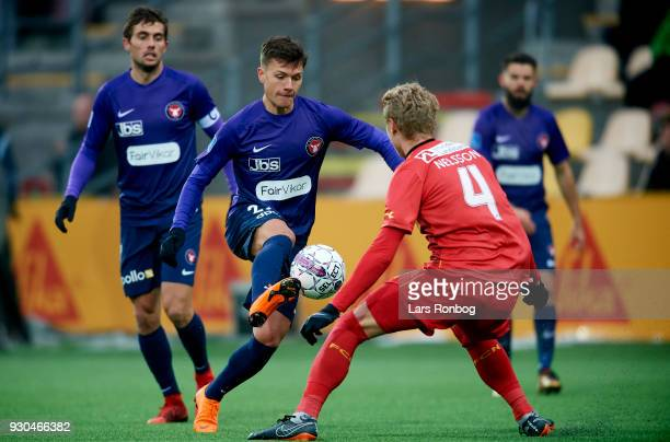 Mikkel Duelund of FC Midtjylland and Victor Nelsson of FC Nordsjælland compete for the ball during the Danish Alka Superliga match between FC...