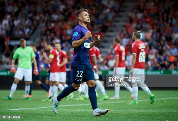 Mikkel Duelund of FC Midtjylland celebrates after scoring their first goal during the Danish Superliga match between Vejle Boldklub and FC...