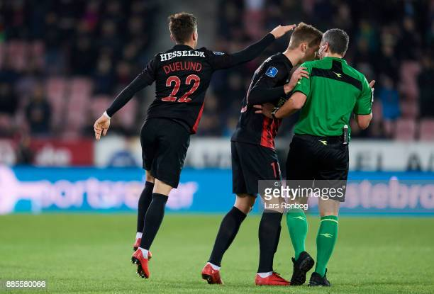 Mikkel Duelund of FC Midtjylland celebrates after scoring their second goal while Alexander Sorloth of FC Midtjylland speaks to Referee Michael...