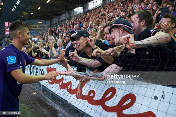 Mikkel Duelund of FC Midtjylland celebrates with the fans after the Danish Superliga match between Vejle Boldklub and FC Midtjylland at Vejle Stadion...