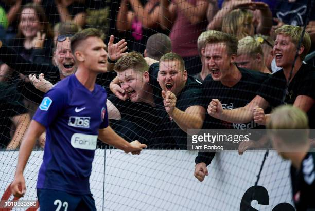 Mikkel Duelund of FC Midtjylland celebrates with the fans after their third goal during the Danish Superliga match between Vejle Boldklub and FC...