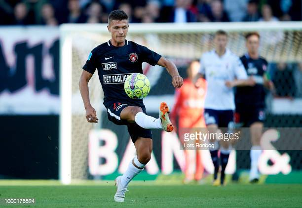 Mikkel Duelund of FC Midtjylland controls the ball during the Danish Superliga match between FC Midtjylland and AGF Aarhus at MCH Arena on July 14...