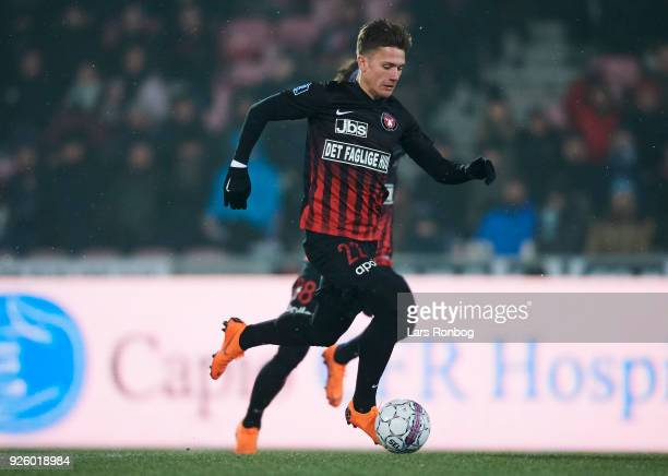Mikkel Duelund of FC Midtjylland controls the ball during the Danish Alka Superliga match between FC Midtjylland and Brondby IF at MCH Arena on March...