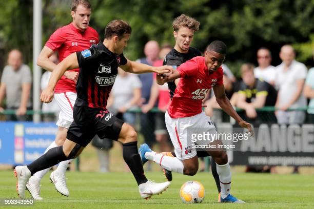Mikkel Duelund of FC Midtjylland Myron Boadu of AZ Alkmaar during the Club Friendly match between AZ Alkmaar v FC Midtjylland at the VV Dirkshorn on...