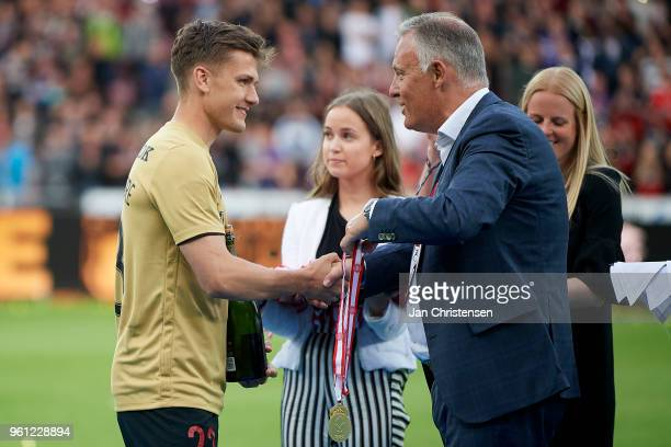 Mikkel Duelund of FC Midtjylland receives his medal after winning the Danish Championship after the Danish Alka Superliga match between FC...