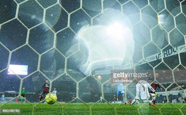 Mikkel Duelund of FC Midtjylland scores the 30 goal against Goalkeeper Hannes Thor Halldorsson of Randers FC during the Danish Alka Superliga match...