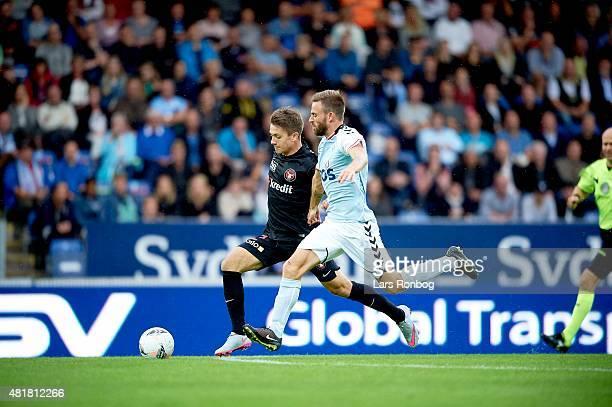 Mikkel Duelund of Midtjylland and Janus Drachmann of Sonderjyske compete for the ball during the Danish Alka Superliga match between Sonderjyske and...