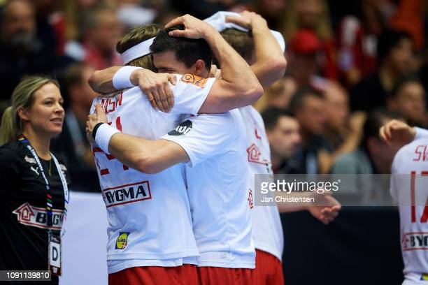 Mikkel Hansen of Denmark and Rasmus Lauge of Denmark celebrate during the IHF Men's World Championships Handball Final between Denmark and Norway in...