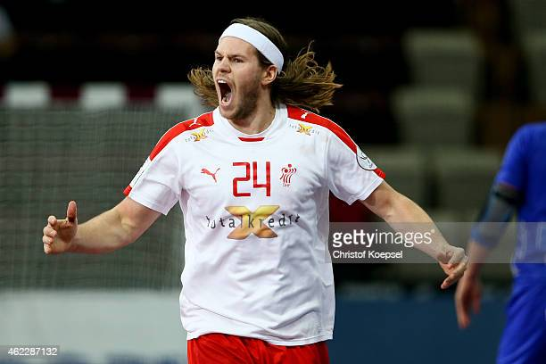 Mikkel Hansen of Denmark celebrates a goal during the eight final match between Iceland and Denmark at Lusail Multipurpose Hall on January 26 2015 in...