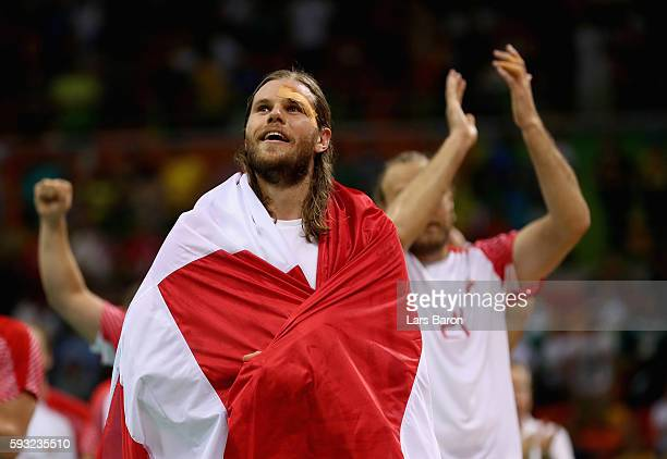 Mikkel Hansen of Denmark celebrates defeating France 2826 to win the gold medal in Men's Handball on Day 16 of the Rio 2016 Olympic Games at Future...