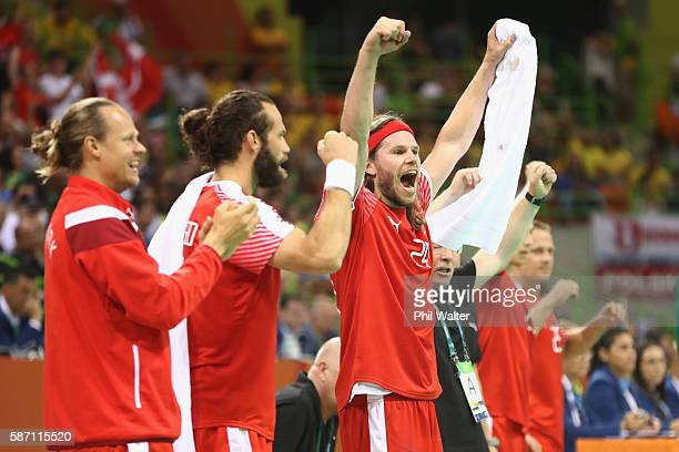 Mikkel Hansen of Denmark celebrates during the Mens Preliminary Group A match between Denmark and Argentina at the Future Arena on Day 2 of the Rio...