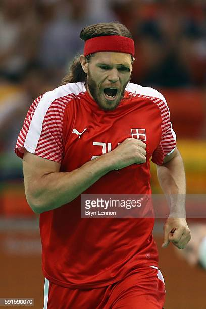 Mikkel Hansen of Denmark celebrates during the Men's Quarterfinal Handball contest between Denmark and Slovenia at Future Arena on Day 12 of the Rio...