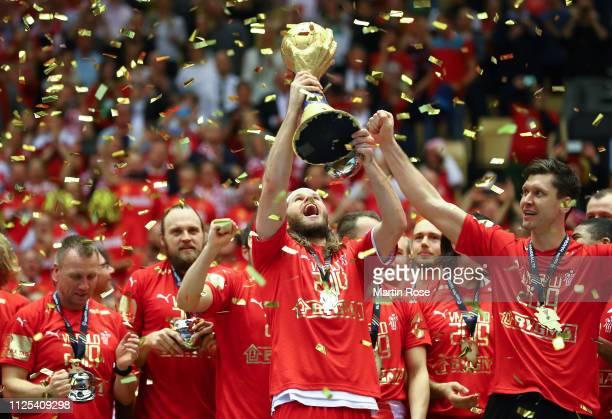 Mikkel Hansen of Denmark celebrates with the trophy after winning the 26th IHF Men's World Championship final between Norway and Denmark at Jyske...